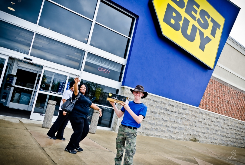 Jacob at Best Buy with His New Nikon D3100