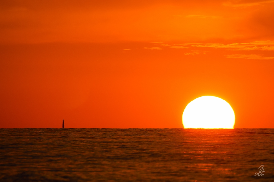 Lighthouse Sunset Over the Gulf of Mexico