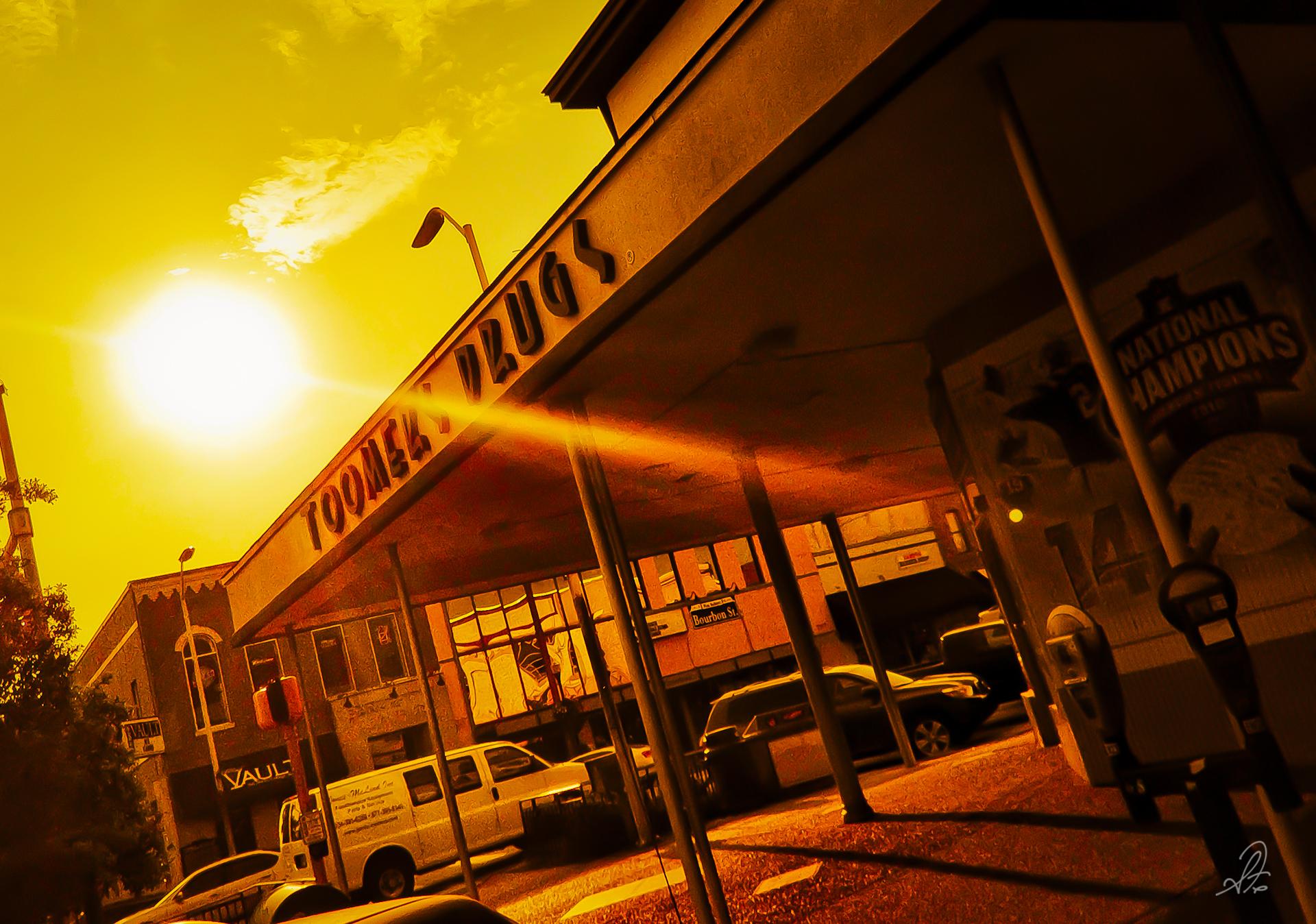 Sun Setting Over Toomer's Drugs in Auburn